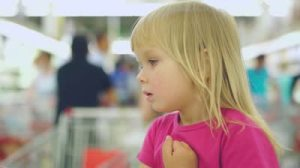 stock-footage-adorable-girl-sit-in-shopping-cart-in-supermarket